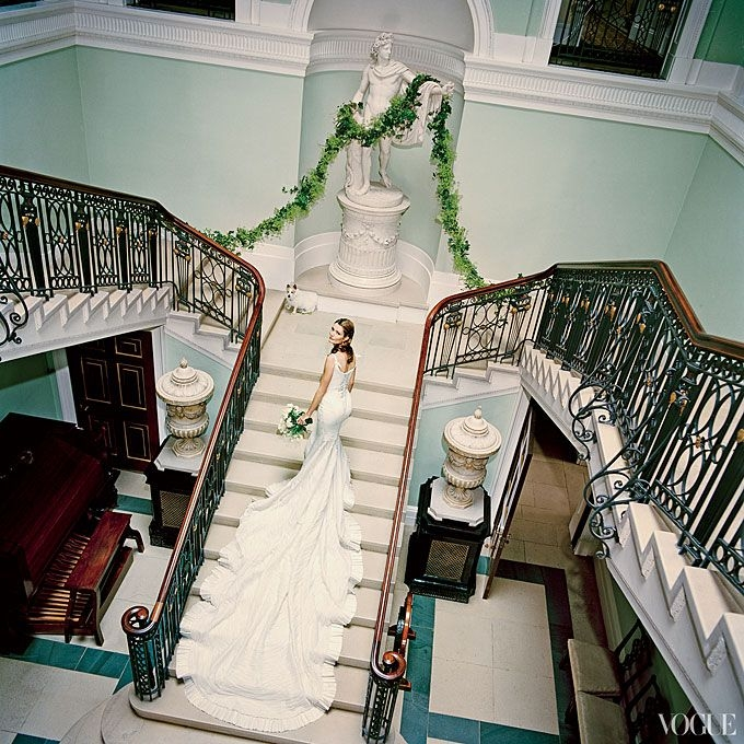 brides plum sykes on the staircase of her second Plum Sykes Wedding Dress
