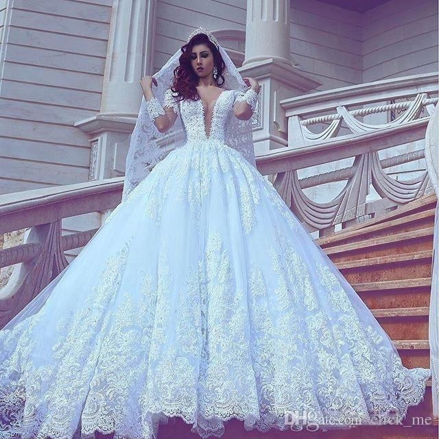 discount arabic puffy lace wedding dresses plunging neckline illusion long sleeves wedding dress with long train custom made v neck bridal gowns Wedding Dresses Poofy
