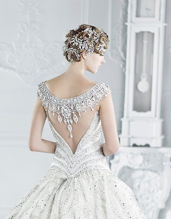 the wedding dress with a dramatic back arabia weddings Wedding Dresses With Dramatic Backs
