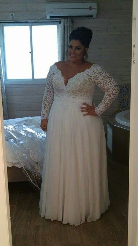 stunning plus size bride in a corset dress with long sleeves Plus Size Undergarments For Wedding Dresses