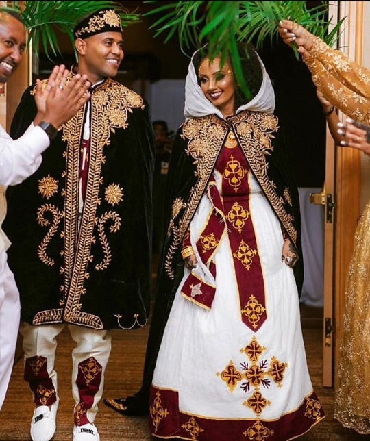 couple in habesha kemis traditional attire for melsi wedding Habesha Wedding Dresses