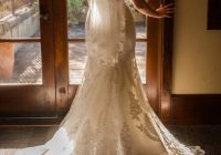 bay area bride poses in front of window with beautiful light Pretty Wedding Dresses Bay Area