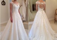 discount 2020 new modest wedding dresses lace cap sleeves covered button applique see through bateau sweep train bridal gowns custom made wedding gown Capped Sleeve Lace Wedding Dress