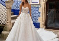 sleeveless deep v neckline crepe ball gown wedding dress with lace inserts Kleinfeld Wedding Dress