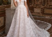 wedding dress with princess cut and off the shoulder sleeves Pronovias Wedding Dresses s